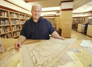 photo - Larry Johnson manages the Oklahoma Images Project and the Oklahoma Room for the  Metropolitan Library System. The Oklahoma Room houses a special collection in the Ronald J. Norick Downtown Library, 300 Park Ave. <strong>PAUL HELLSTERN - The Oklahoman</strong>