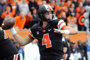 Photo - Oregon State quarterback Sean Mannion throws against Colorado in the first half of an NCAA college football game on Saturday, Sept 28, 2013, in Corvallis, Ore. Oregon State beat Colorado 44-17. (AP Photo/Greg Wahl-Stephens)