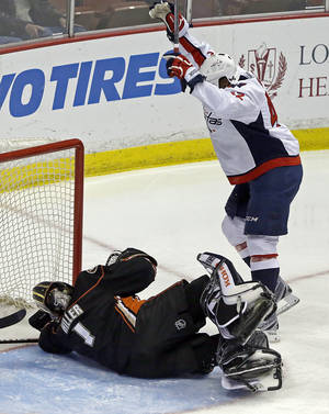 Photo - Washington Capitals right winger Joel Ward (42) celebrates his goal over Anaheim Ducks goalie Jonas Hiller (1), of Switzerland, in the first period of an NHL hockey game Tuesday, March 18, 2014. (AP Photo/Reed Saxon)