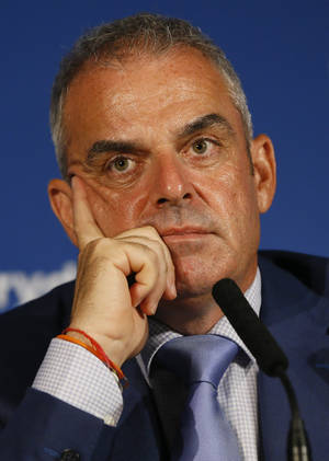 Photo - European Ryder cup team captain Paul McGinley listens during a press conference at Wentworth Golf Club to announce his three wild card selections for his team to play at Gleneagles in Scotland against the USA, in Wentworth England, Tuesday, Sept. 2, 2014. (AP Photo/Kirsty Wigglesworth)