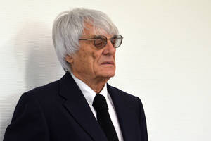 """Photo - Formula One boss Bernie Ecclestone waits in the court in Munich , southern Germany,  Tuesday, July 1, 2014. Ecclestone is charged with bribery and incitement to breach of trust """"in an especially grave case"""" over a US $44 million payment to a German banker, that prosecutors allege was meant to facilitate the sale of the Formula One Group to a buyer of Ecclestone's liking. (AP Photo/Kerstin Joensson,Pool)"""