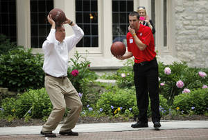 Photo -   In a Tuesday, May 15, 2012 photo, Ohio Governor John Kasich, left, takes a shot as OSU's Aaron Craft waits his turn in a game of Horse at the Governor's residence in Bexley, Ohio. A reception recognizing Ohio's NCAA Tourney Sweet 16 teams was held at the house. (AP Photo/Columbus Dispatch, Shari Lewis)