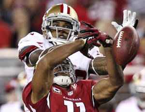 Photo -   San Francisco 49ers defensive back Chris Culliver breaks up a pass intended for Arizona Cardinals wide receiver Larry Fitzgerald (11) during the first half of an NFL football game, Monday, Oct. 29, 2012, in Glendale, Ariz. (AP Photo/Paul Connors)