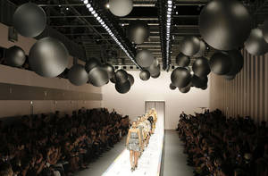 Photo -   Models wear creations part of the Fendi women's Spring-Summer 2013 fashion collection, during the fashion week in Milan, Italy, Saturday, Sept. 22, 2012. (AP Photo/Antonio Calanni)