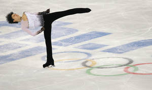Photo - Yuzuru Hanyu of Japan competes in the men's free skate figure skating final at the Iceberg Skating Palace during the 2014 Winter Olympics, Friday, Feb. 14, 2014, in Sochi, Russia. (AP Photo/Vadim Ghirda)