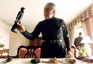 Photo - FILE - In this Jan. 30, 2003 file photo, G.I. Joe creator Don Levine holds up his original scuba diver G.I. Joe as other original prototypes lie on top of a table in Providence, R.I. Levine died of cancer early Thursday, May 22, 2014, at Home & Hospice Care of Rhode Island, said his wife, Nan. He was 86. (AP Photo/Victoria Arocho, File)