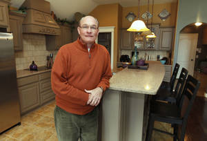 Photo - Todd Booze, president of construction for Ideal Homes and 2014 president of the Oklahoma State Home Builders Association, is show in an Ideal Homes model at 2341 SW 135 in the Country Place addition. <strong>PAUL HELLSTERN - The Oklahoman</strong>
