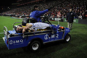 Photo - Injured Atletico de Madrid's Filipe Luis of Brazil, leaves the pitch during their Spanish Copa del Rey round-8 second leg soccer match between Athletic Bilbao and Atletico de Madrid, at San Mames stadium, in Bilbao, northern Spain, Wednesday, Jan. 29, 2014.   (AP Photo/Alvaro Barrientos)