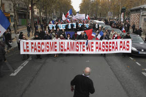 "Photo -   People hold a banner reading: 'islamic fascism shall not pass"" during a demonstration in Paris, Saturday Nov.10, 2012. France is home to Western Europe's largest population of Muslims, estimated to be at least 5 million even though the government does not provide official figures. Many have family roots in former French colonies in northern Africa. (AP Photo/Thibault Camus)"