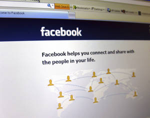 Photo -   This June 20, 2012 photo shows a Facebook login page on a computer screen in Oakland, N.J. Facebook is expected to report their quarterly financial results after the market closes on Thursday, July 26, 2012. (AP Photo/Stace Maude)
