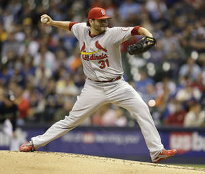 Photo - St. Louis Cardinals starting pitcher Lance Lynn throws against the Milwaukee Brewers during the first inning of a baseball game Saturday, Sept. 21, 2013, in Milwaukee. (AP Photo/Jeffrey Phelps)