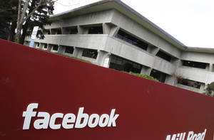 Photo - The Facebook headquarters are shown in Palo Alto, Calif.  AP Photo