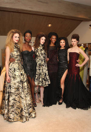 "Photo - Models Allie Ayers, Safi Isamotu, Alyssa Siler, Kristina Haley, Adrianna Standfill, Micayla Curry wear designs by South African designers for ""A Night for Africa"" fundraiser. PHOTO BY DAVID FAYTINGER, FOR THE OKLAHOMAN   <strong></strong>"