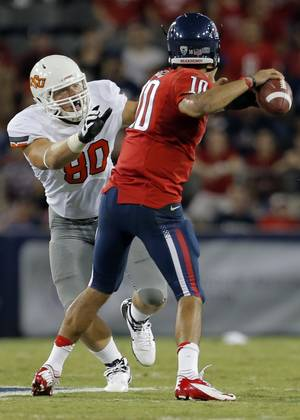 photo - Oklahoma State&#039;s Cooper Bassett (80) pressures Arizona&#039;s Matt Scott (10) as he throws the ball during the college football game between the University  of Arizona and Oklahoma State University at Arizona Stadium in Tucson, Ariz.,  Saturday, Sept. 8, 2012. Photo by Sarah Phipps, The Oklahoman
