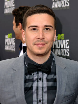 Photo - IMAGE DISTRIBUTED FOR MTV - Vinny Guadagnino arrives at the MTV Movie Awards in Sony Pictures Studio Lot in Culver City, Calif., on Sunday April 14, 2013. (Photo by John Shearer/Invision for MTV/AP Images) ORG XMIT: INVL