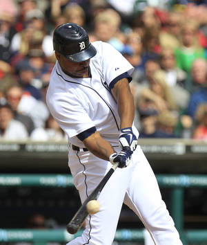 Photo -   Detroit Tigers designated hitter Delmon Young singles to right field to score Miguel Cabrera during the fourth inning of a baseball game at Comerica Park in Detroit, Sunday, Sept. 23, 2012. (AP Photo/Carlos Osorio)