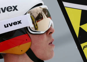 Photo - Germany's Eric Frenzel looks at the hill after his attempt at a men's nordic combined training session at the 2014 Winter Olympics, Tuesday, Feb. 11, 2014, in Krasnaya Polyana, Russia. (AP Photo/Dmitry Lovetsky)