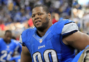 photo -   In this Nov. 18, 2012 photo, Detroit Lions defensive tackle Ndamukong Suh (90) watches from the bench during the fourth quarter of an NFL football game against the Green Bay Packers at Ford Field in Detroit. Suh was issued a traffic citation by a police officer who said he saw Suh driving fast and passing cars from the right lane of a suburban Detroit roadway. The Lathrup Village officer gave Suh a ticket on Nov. 15, 2012 for driving without due care and caution. (AP Photo/Carlos Osorio)