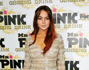 Photo - FILE - In this Oct. 11, 2012 file photo, Lindsay Lohan attends the Mr. Pink Ginseng launch party at the Beverly Wilshire hotel in Beverly Hills, Calif. An attorney for Lindsay Lohan says New York City prosecutors will not charge her for an alleged fight at a Manhattan nightclub last November. Attorney Marc Heller says the actress faces no formal charges after prosecutors were unable to gather sufficient evidence to prove the case. Lohan was arrested Nov. 29 on a charge of misdemeanor assault after an incident with Tiffany Mitchell at the club Avenue in the city's trendy Meat Packing district. (Photo by Richard Shotwell/Invision/AP, File)