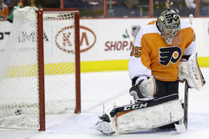 Photo - Philadelphia Flyers' Steve Mason cannot block a goal by Columbus Blue Jackets' Cam Atkinson during the first period of an NHL hockey game, Thursday, Dec. 19, 2013, in Philadelphia. (AP Photo/Matt Slocum)