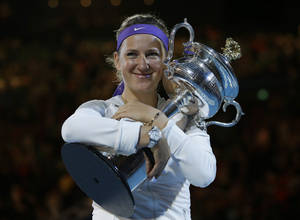 photo - Victoria Azarenka of Belarus hugs her trophy after winning the women's final against China's Li Na at the Australian Open tennis championship in Melbourne, Australia, Saturday, Jan. 26, 2013. (AP Photo/Andy Wong)