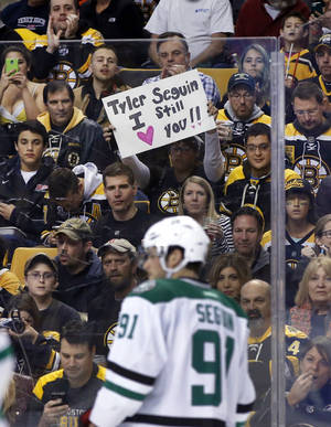 Photo - A fan holds up a sign for former Boston Bruin and current Dallas Stars center Tyler Seguin (91) during the first period of an NHL hockey game in Boston on Tuesday, Nov. 5, 2013. (AP Photo/Elise Amendola)