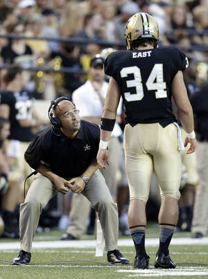 Photo - Vanderbilt head coach James Franklin instructs long snapper Andrew East (34) in the first quarter of an NCAA college football game against Austin Peay on Saturday, Sept. 7, 2013, in Nashville, Tenn. (AP Photo/Mark Humphrey)
