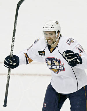 Photo - OKLAHOMA CITY BARONS: Oklahoma City's Colin McDonald celebrates after scoring the Barons' first goal against Milwaukee during their AHL hockey game at the Cox Convention Center in Oklahoma City on Sunday, Nov. 21, 2010. Photo by John Clanton, The Oklahoman ORG XMIT: KOD