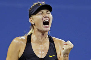 Photo -   Maria Sharapova, of Russia, pumps her fist as she wins a point against Nadia Petrova, of Russia, in the fourth round of play at the U.S. Open tennis tournament, Sunday, Sept. 2, 2012, in New York. (AP Photo/Charles Krupa)