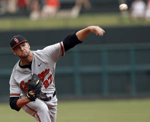 Photo - Oklahoma State's Tyler Nurdin throws a pitch during the Bedlam baseball game between the University of Oklahoma and Oklahoma State University at the Chickasaw Bricktown Ballpark in Oklahoma CIty, Saturday, May 11, 2013. Photo by Sarah Phipps, The Oklahoman