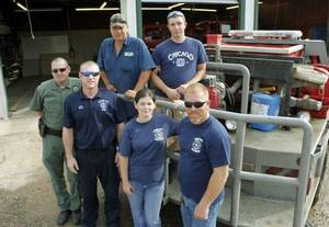 photo - Some of the members of the volunteer Fire Dept. in Elmore City, OK, Friday, July 29, 2011. Front L-R: Brynn Barnett, Les Fowler, Lauri Martin, and Scott Martin. Behind: Denis Russell and Gavin Brassfield. By Paul Hellstern, The Oklahoman ORG XMIT: KOD