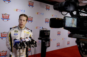 Photo - Driver Brad Keselowski answers questions during NASCAR auto racing media day at Daytona International Speedway in Daytona Beach, Fla., Thursday, Feb. 13, 2014. (AP Photo/John Raoux)
