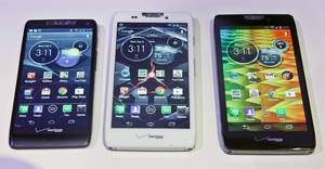 photo -   Motorola's three new Droid Razr smartphones, the Droid Razr M, center, the Droid Razr HD, center, and the Droid Razr Maxx HD, are unveiled at a press conference on Wednesday, Sept. 5, 2012. The phones are the first from Motorola as a part of Google. (AP Photo/Bebeto Matthews)