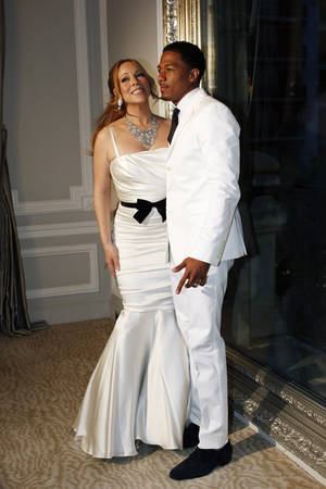 Photo -   U.S singer Mariah Carey, left, and her husband Nick Cannon pose in Paris, for the renewal of their wedding vows, Friday, April 27, 2012. (AP Photo/Thibault Camus)