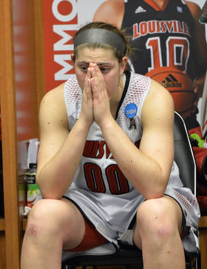 Photo - Louisville's Sara Hammond pauses in the locker room following a regional final against Maryland in the NCAA women's college basketball tournament Tuesday, April 1, 2014, in Louisville, Ky. Maryland defeated Louisville 76-73. (AP Photo/Timothy D. Easley)