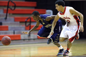 Photo - Southmoore's Chelvin Webb steals the ball from Del City's Stephen Edwards during the boys basketball game between Southmoore and Del City at Del City High School in Del City,  Tuesday, Feb. 5, 2013.Photo by Sarah Phipps, The Oklahoman