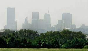 Photo - Haze obscures the view of the downtown skyline during an  ozone alert on Tuesday, Aug. 25, 2009, in  Oklahoma  city, Okla. Photo by Chris Landsberger