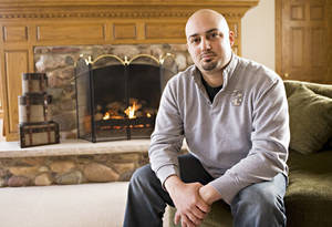 Photo - This photo taken in 2011 shows Abe Mashal posing for a photo at his  home in  St. Charles, Ill. The Obama administration is promising to change the way travelers can ask to be removed from its no-fly list of suspected terrorists banned from air travel. One of the plaintiffs in the Portland lawsuit, Abe Mashal, was unable to print his boarding pass before a flight out of Chicago four years ago. A counter representative told him he was on the no-fly list and would not be allowed to board. Mashal was surrounded by about 30 law enforcement officials, he said. (AP Photo/Sun-Times Media)  MANDATORY CREDIT, MAGS OUT,