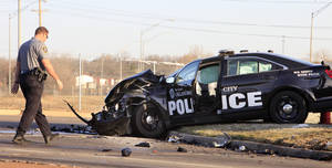 Photo -  Oklahoma City police investigate a wreck involving a pickup and an Oklahoma City police car Thursday at the intersection of NW 36 and the Interstate 44 northbound off-ramp in Oklahoma City. Photo by Paul B. Southerland, The Oklahoman  <strong>PAUL B. SOUTHERLAND -   </strong>
