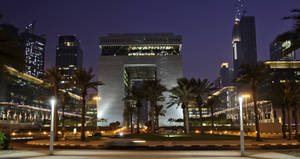 photo -   A night view of the Gate building is seen at the Dubai International Financial Center, DIFC, in Dubai, United Arab Emirates, Sunday Aug. 7, 2011. Stocks tumbled across the Middle East on Sunday as most regional markets reopened following the historic downgrade of the United States' credit rating. The region's markets mostly operate Sunday to Thursday. That meant they were the first to react to credit rating agency Standard & Poor's decision late Friday to cut the U.S. level one notch to AA+ from its top AAA rating. (AP Photo/Kamran Jebreili)