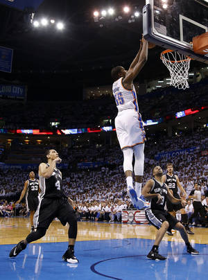 Photo - Oklahoma City's Kevin Durant (35) dunks in between San Antonio's Danny Green (4), Tony Parker (9) and Tiago Splitter (22)  during Game 6 of the Western Conference Finals in the NBA playoffs between the Oklahoma City Thunder and the San Antonio Spurs at Chesapeake Energy Arena in Oklahoma City, Saturday, May 31, 2014. Photo by Bryan Terry, The Oklahoman