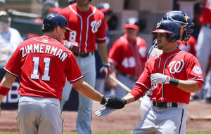 Photo - Washington Nationals' Ian Desmond, right, is congratulated by Ryan Zimmerman after his two-run homer against the San Diego Padres during the second inning of a baseball game, Sunday, June 8, 2014, in San Diego. (AP Photo/Lenny Ignelzi)