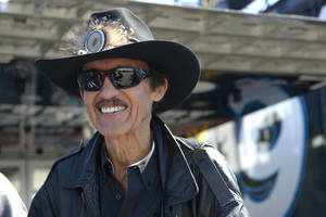 Photo - Car owner and and even-time NASCAR champion Richard Petty stands outside his hauler in the garage area during qualifying for the NASCAR Daytona 500 auto race at Daytona International Speedway in Daytona Beach, Fla., Sunday, Feb. 16, 2014. (AP Photo/Phelan M. Ebenhack)