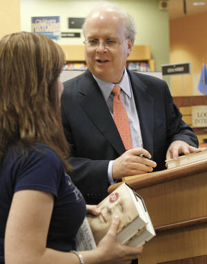 "Photo - Karl Rove, former senior adviser to President George W. Bush, signs copies of his book, ""Courage and Consequence,""  on Monday in Oklahoma City. AP Photo"