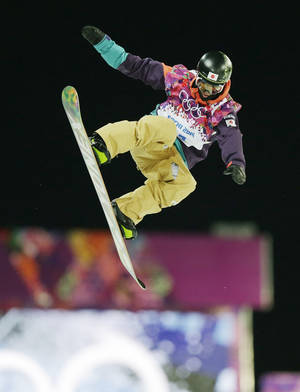 Photo - Japan's Ayumu Nedefuji gets air during a snowboard half pipe training session at the Rosa Khutor Extreme Park at the 2014 Winter Olympics, Monday, Feb. 10, 2014, in Krasnaya Polyana, Russia.  (AP Photo/Andy Wong)
