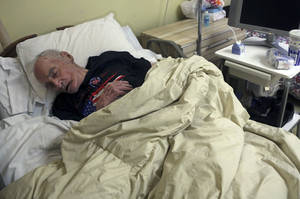 photo - In this Jan. 26 2013 photo, Morris Markowitz sleeps in his room at the Crown Nursing and Rehabilitation Center in the Brooklyn borough of New York. Markowitz's daughter Sherri Gonzalez said that for two weeks after Superstorm Sandy she made frantic phone calls from her home in Miami before her family was able to locate her 90-year-old father, who had been evacuated from the flooded Shoreview Nursing Home to the Crown Nursing and Rehabilitation Center. In Superstorm Sandy's wake, health experts and regulators are warning that thousands of nursing homes nationwide are still ill-prepared for a natural disaster. The late October storm was the latest in a string of disasters to reveal gaps in emergency planning, despite an industry-wide effort to improve preparedness in the years since Hurricane Katrina.  (AP Photo/Mary Altaffer)
