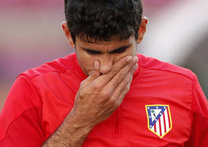 Photo - Atletico's Diego Costa gestures, during a training session ahead of Saturday's Champions League final soccer match between Real Madrid and Atletico Madrid, in Luz stadium in Lisbon, Portugal, Friday, May 23, 2014. (AP Photo/Daniel Ochoa de Olza)