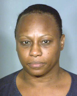 Photo - This booking photo provided by the Clark County Detention Center in Las Vegas, Saturday, Dec. 22, 2012, shows 50-year-old Brenda Stokes, who also uses the name Brenda Wilson and Brenda Stokes Wilson. Police in Las Vegas have issued a plea for information about 10-year-old Jade Morris after she failed to return home Friday, Dec. 21, 2012, from a shopping trip with a woman who is thought to be Stokes. Stokes was arrested that night and accused of slashing the face of a female co-worker at the Bellagio resort on the Las Vegas Strip. She made her first appearance in Las Vegas Justice Court, Wednesday, Dec. 26, 2012. (AP Photo/Clark County Detention Center )