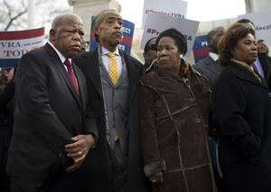 Photo - From left, Rep. John Lewis, D-Ga., Rev. Al Sharpton, Rep. Sheila Jackson Lee, D-Texas, and Rep. Barbara Lee, D-Calif., stand outside the Supreme Court in Washington, Wednesday, Feb. 27, 2013, during a rally before oral arguments in the Shelby County, Ala., v. Holder voting rights case. The justices are hearing arguments in a challenge to the part of the Voting Rights Act that forces places with a history of discrimination, mainly in the Deep South, to get approval before they make any change in the way elections are held. (AP Photo/Evan Vucci)