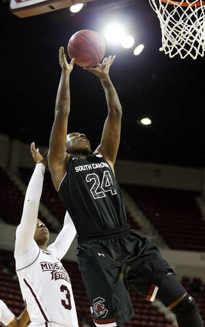 Photo - South Carolina forward Aleighsa Welch (24) shoots a layup as Mississippi State forward Breanna Richardson (3) defends in the second half of an NCAA college basketball game in Starkville, Miss., Thursday, Feb. 6, 2014. No. 6 South Carolina won 71-64. (AP Photo/Rogelio V. Solis)